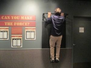 At the Crime Museum. Apparently you have to do 5 pull ups to qualify for the police force. John qualifies